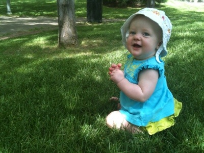 Our daughter Olivia posing for the camera on the grass