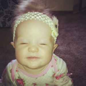 Our daughter Olivia making faces as the camera.